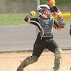 JIM VAIKNORAS/Staff photo Pentucket's catcher holds a runner on against North Reading during their game at the Pines in Groveland.
