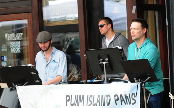 JIM VAIKNORAS/Staff photo Plum Island Pans perform at the first outdoor  Farmer Market of the season at the Tannery in Newburyport Sunday morning.