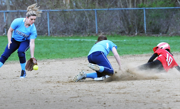 BRYAN EATON/Staff Photo. Triton second baseman Taylor Johnson catches the ball which got past shortstop Bridget Sheehan allowing Amesbury's Lauren Fedorchuk make second base.