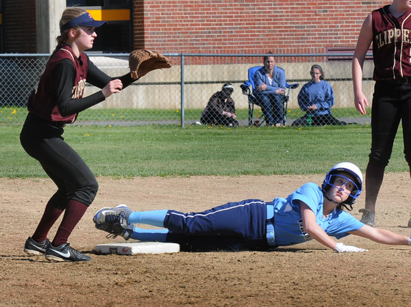 BRYAN EATON/Staff Photo. Triton's Kendall Mitchell slides into second on a steal as Newburyport shortstop Annie Siemesko waits for the throw.
