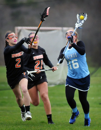 BRYAN EATON/Staff Photo. Triton midfielder Hope Leonard passes the ball with Ipwich's Kelsey Daly defending.