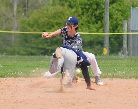 JIM VAIKNORAS/Staff photo The ball bounces by Triton's Dylan Copeland as  Essex Tech's Jackson Lee steals second  Saturday at Triton.