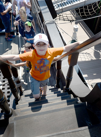BRYAN EATON/Staff Photo. Keith Welch, 7, from Amesbury Elementary School heads up the steps to the forecastle deck.