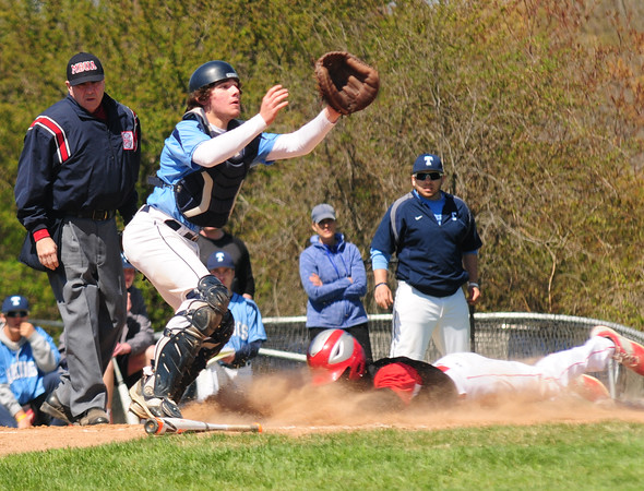 JIM VAIKNORAS/Staff photo Triton's Lewi L'Huereux waits for the throw as Amesbury #5.. slides safely home during their game at Triton saturday.