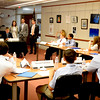 JIM VAIKNORAS/Staff photo  Alison Lashendock, Curan Van DerWielen, and Jack Lashendock speak to delegates at the Model UN at Newburyport High School Saturday.
