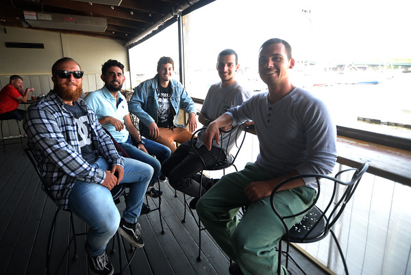 JIM VAIKNORAS/Staff photo Sailors from the El Galeon, Xavi Canals, Fer Iglesias, Alex Borras, Pepe Vazquez-Burney and Pablo Tejada, relax at teh Black Cow in Newburyport.