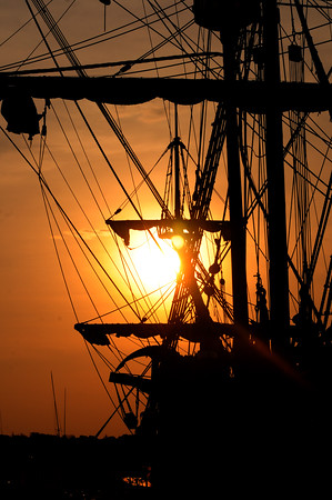 JIM VAIKNORAS/Staff photo The sun sets behind  the tall ship El Galeon Friday night in Newburyport.