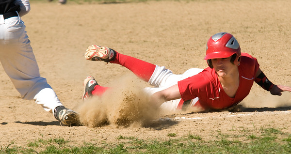JIM VAIKNORAS/Staff photo Amesbury's Bradley Kelleher dives safely back to first during their game against Ipswich at Amesbury Thursday.