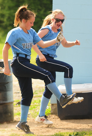 JIM VAIKNORAS/Staff photo Triton's kendall Mitchell and Kendra Beauparlant dance between inning during their game against Pentucket at Triton on Wednesday.