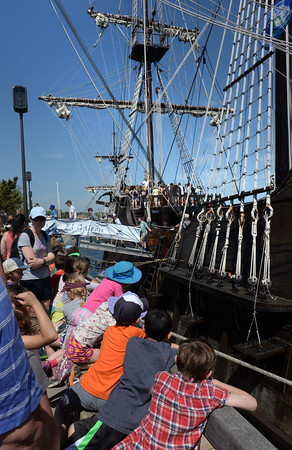 BRYAN EATON/Staff Photo. Students from Amesbury Elementary School look at El Galeon as they await their turn to board.