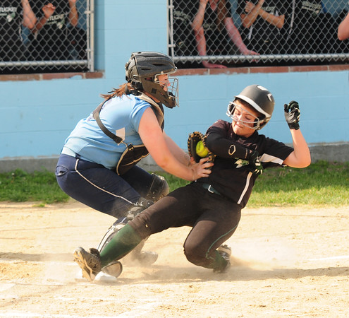 JIM VAIKNORAS/Staff photo Pentucket's Courtney Zimmerman is out at home after a tag by Triton's Julia Hartman during their game at Triton Wednesday.