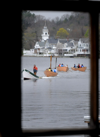 BRYAN EATON/Staff Photo. Amesbury High School students head back to Lowell's Boat Shop in their dories on Thursday morning. The students had been using math skills for triangulation exercises as they rowed to three different locations nearby.