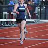 BRYAN EATON/Staff Photo. Triton's Bella Lesinski in the 400 hurdles.