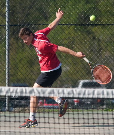 JIM VAIKNORAS/Staff photo Amesbury's Grant Bellino druing his match against Danvers' Jimmy McCarriston.