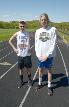 JIM VAIKNORAS/Staff photo Amesbury Track stars Brian Chabot and Cole Legg at the track in Amesbury.