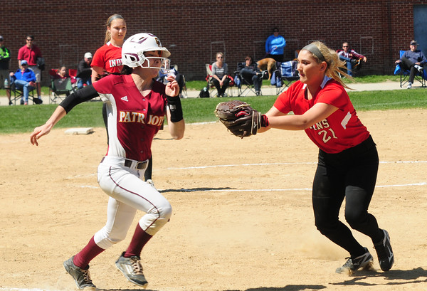 JIM VAIKNORAS/Staff photo Amesbury's Zoe Fitzgerald tags out a runner during the Indian's game against Concord Carlise at Amesbury.