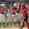 JIM VAIKNORAS/Staff photo Amesbury Caity Baker walks back to home plate as  Concord Carlise celebrate a run at Amesbury Saturday.
