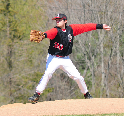 JIM VAIKNORAS/Staff photo Amesbury pitcher #20 throws at Triton Saturday morning.
