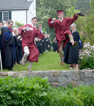 "JIM VAIKNORAS/Staff photo Graduates 'jump the wall"" at the Governor's Academy Commemcement in Byfield Sunday morning."
