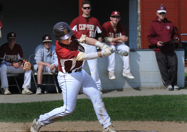BRYAN EATON/Staff Photo. Newburyport's Quin Stot connects for a double sending home Casey McLaren.