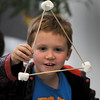 BRYAN EATON/Staff Photo. Max Fitzwater, 7, checks to see if the marshmallows are secure to the barbecue skewers in the Mad Scientist Club at Salisbury Elementary School in the afterschool program Explorations. The unit was a component of catapults the children were making from kitchen items.