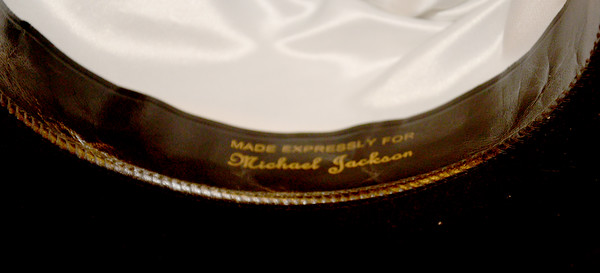 JIM VAIKNORAS/staff photo Inside of the brim of Michael Jackson along hat up for auction at ohn McInnis Auctioneers in Amesbury.
