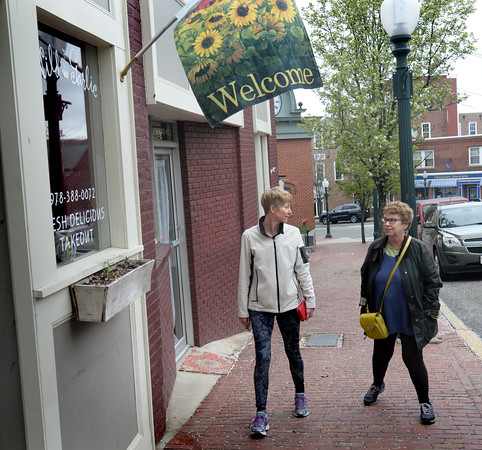 BRYAN EATON/Staff Photo. Jennifer Freeman of Pause Yoga in downtown Amesbury, left, and reiki master Janice Tangney, walk from the studio on their way to lunch.