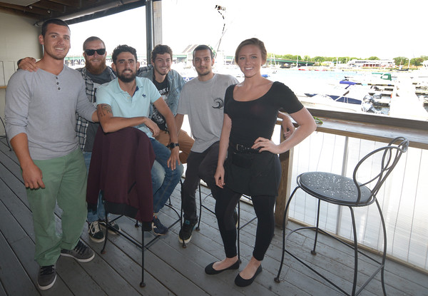 JIM VAIKNORAS/Staff photo Sailors from the El Galeon, Paplo Tejada, Xavi Canals, Fer Iglesias, Alex Borras and Pepe Cazquez-Burney pose with waitress Shauna Reardon at the Black Cow in Newburyport, members of the crew used their day off to enjoy the area.