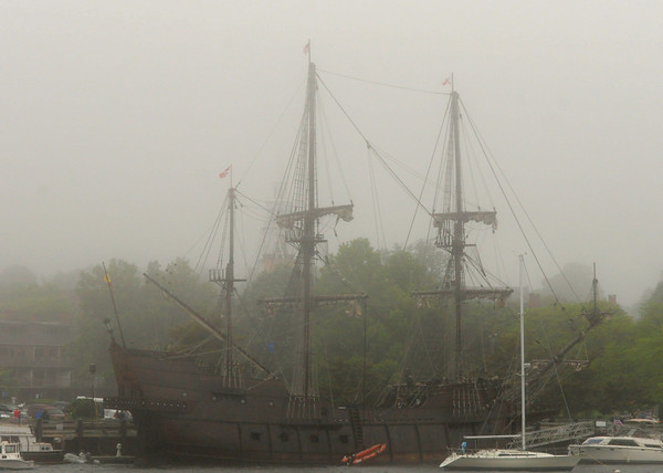 JIM VAIKNORAS/Staff photo  Looking like a ghost ship, El Galeon sits in Sunday's early morning fog along Newburyport's waterfront.