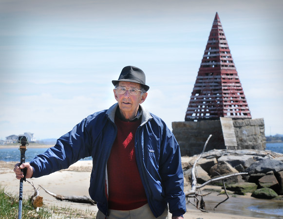 BRYAN EATON/Staff Photo. Amesbury's Ted Bailey at Ben Butler's Toothpick at Salisbury Beach with his geocache mounted on his walking stick.