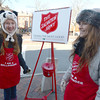 Newburyport: Melanie and Alexis Lane are bundled against the cold as they ring the bell for the Salvation Army on State Street Saturday moning. Jim Vaiknoras/staff photo