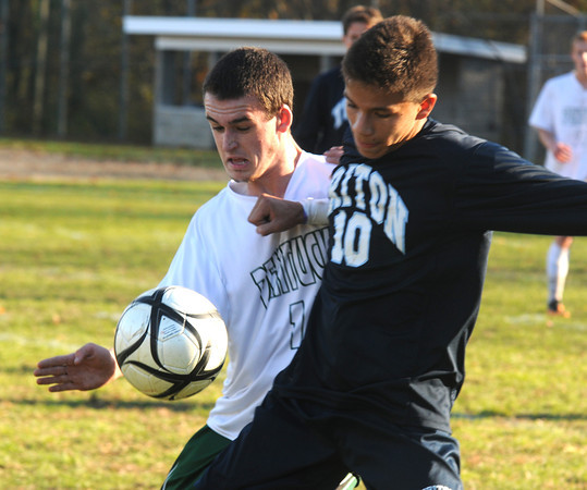 West Newbury: Triton's Jacob Papanicolaou fights for the ball with Pentuckets Brandon O'Neal during their game at Pentucket Friday. The Sachems won the game 3-0. Jim Vaiknoras/staff photo