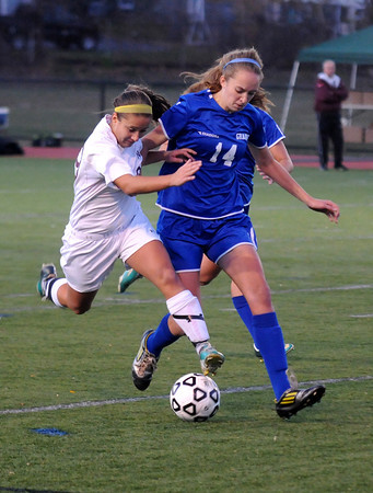 Worcester: Newburyport's Jaycie Triandafilou fight Granby's Meghan Sullivan for the ball during their game at Foley Stadium in Worcester. The Clipper's won the game 1-0, giving them the Division 3 State Championship. Jim Vaiknoras/staff photo