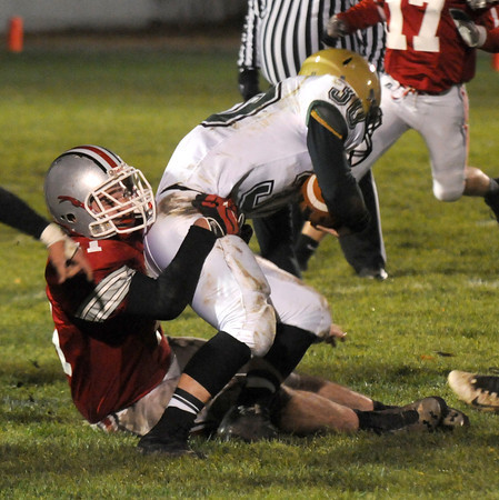Amesbury: Amesbury's Spencer Fournier pull down a North Reading runner during their game at Amesbury. Jim Vaiknoras/staff photo