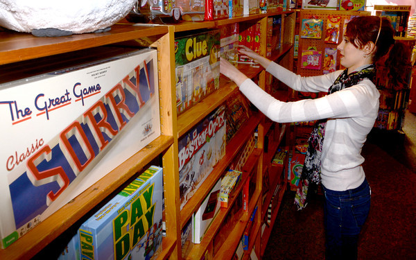 Neburyport: Maddie O'Brien of West Newbury rearrainges some of the games for sale at Eureke at the Tannery in Newburyport Friday. Maddie is a student at Pentucket High School and has been working at the store since July. Jim Vaiknoras/staff photo