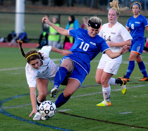 Worcester: Newburyport's Carly Brand collides with Granby's Tara Mikalchus during their game at Foley Stadium in Worcester,The Clipper's won the game 1-0, giving them the Division 3 State Championship. Jim Vaiknoras/staff photo