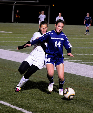 Woburn:  Triton's Hailee Poulin fights for the ball with Lynnfield's Kelly Look during their game at Woburn High school. Jim Vaiknoras/staff photo