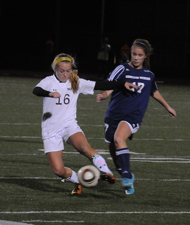 Lynn: Newburyport's Isabella Palma fights for the ball with Hamilton-Wenham's Jillian Kefalas during their game at Manning Field in Lynn. Jim Vaiknoras/staff photo