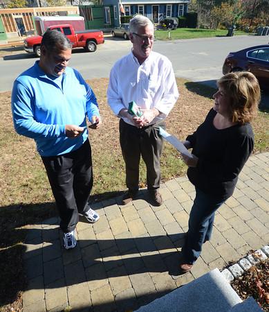 Newburyport: Newburyport mayoral candidate Sichard Sullivan talks with voters Marianne and Charlei Ciovacco Saturday. Jim Vaiknoras/staff photo