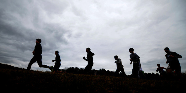 Amesbury: Runners in the Cider Hill 5K Trail Run take off under cold cloudy skyes Sunday morning at Cider Hill Farm in Amesbury. Jim Vaiknoras/staff photo