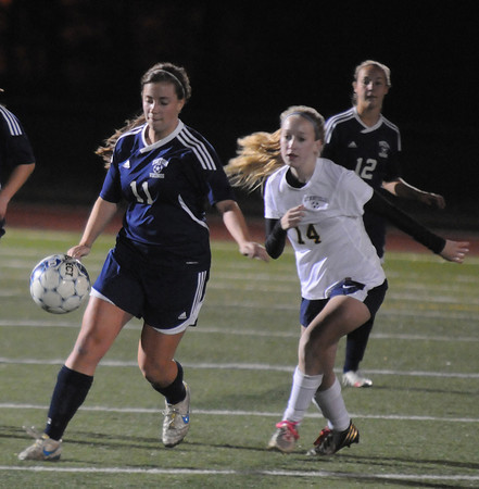 Woburn:  Triton'sTeresa Beniotfights for the ball with Lynnfield's Emily Lucich during their game at Wburn High. Jim Vaiknoras/staff photo
