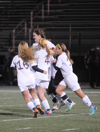 Lynn:Teammates celebrate Newburyport's Carly Brand's second first half goal against Hamilton-Wenham at Manning Field in Lynn. Jim Vaiknoras/staff photo