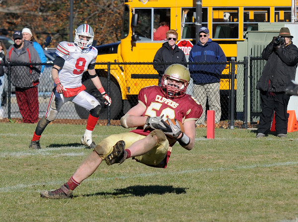 Newburyport: Newburyport's Dillon Guthro intecepts a pass late in the 4th quarter against Amesbury during the Clippers 21-7 victory over the Indians at World War Memorial Stadium in Newburyport Thursday. Jim Vaiknoras/staff photo