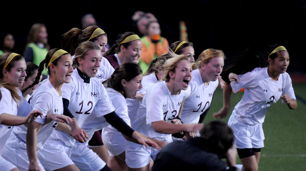 Worcester:Newburyport's girl soccer team rushes the field after their 1-0 victory over Granby at Foley Stadium in Worcester, giving them the Division 3 State Championship. Jim Vaiknoras/staff photo