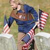 Newburyport: Brownie Kate Powers replaces flags at Veteran's Cemetary in Newburyport Monday morning. Brownies from across the city took time after the Veteran's Day ceremony to mark graves with flags. Jim Vaiknoras/staff photo