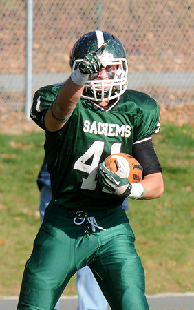 West Newbury: Pentucket's Andrew Noyes reacts after scoring against Hamilton -Wehman  during their game at Pentucket Saturday. Jim Vaiknoras/staff photo