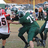 West Newbury: Pentucket's Ryan Kuchar looks for a reciever down field against Watertown during their game at Pentucket Saturday. Jim Vaiknoras/staff photo