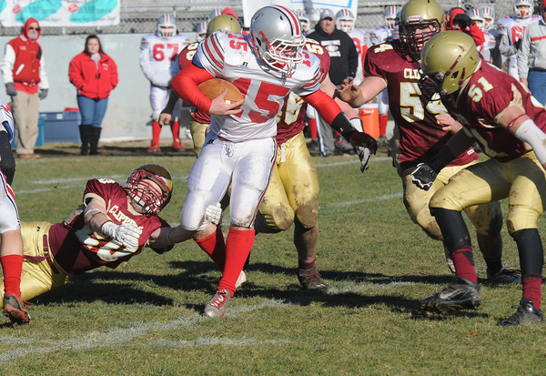 Newburyport:  Amesbury's Mac Short looks for running room against Newburyport during the Clippers 21-7 victory over the Indians at World War Memorial Stadium in Newburyport Thursday. Jim Vaiknoras/staff photo