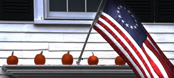 Amesbury: A early American flag and pumpkins decorate a home along Main Street in Amesbury. Jim Vaiknoras/staff photo