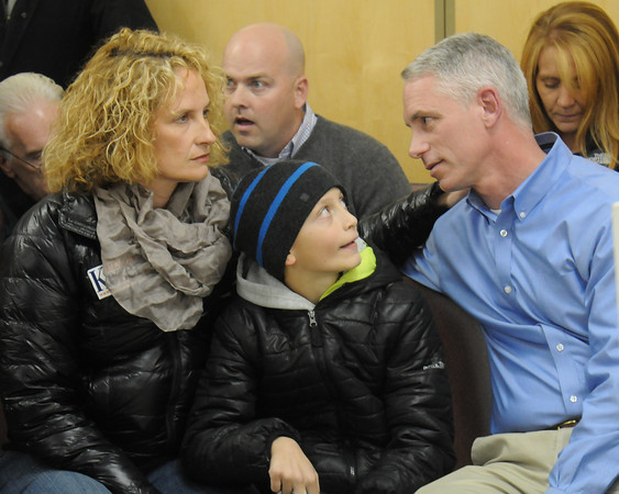 Amesbury: Mayoral Thacher Kezer along with his son Thatcher and wife Claire wait for the voting totals at Amesbury high School. Jim Vaiknoras/staff photo
